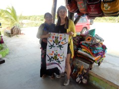 In Cozumel buying hand embroidered table runner from Isaura. Her dress was beautiful but she was too shy to pose.